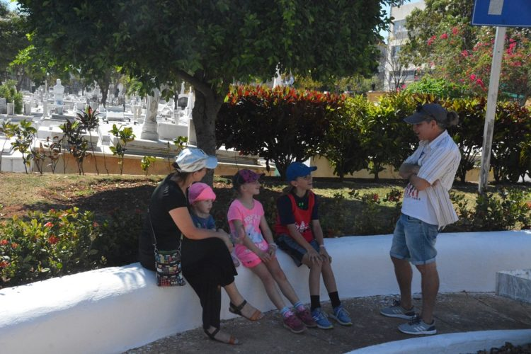 Hanging in the shade at the Old Havana cemetery on our day trip with kids